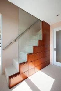 Wooden Cabinets Built into Side of Stairs - McComas Lacina Construction